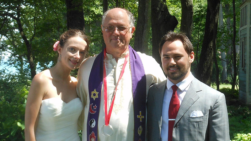 George Wolfe with bridal couple